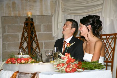 Bride and groom sitting at table at ceremony Stock Photo - 604800
