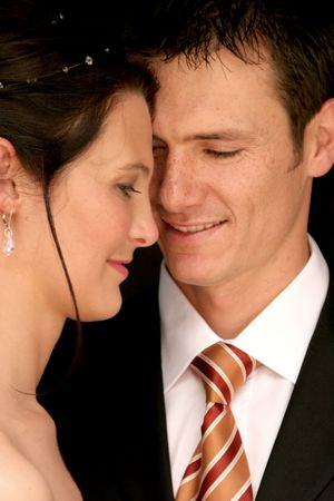 Bride and grooms faces close together on wedding day Stock Photo - 604801
