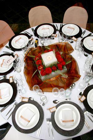 centerpiece: A Table set for a wedding reception