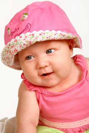 A baby girl sitting with a hat on her head Stock Photo - 619393
