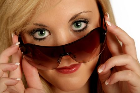 Young Businesswoman taking of her sunglasses photo