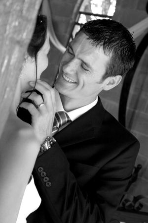 New husband smiling and touching his brides face Stock Photo - 703734