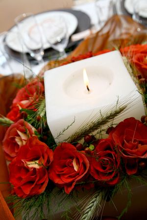 A centerpiece on a table made of roses