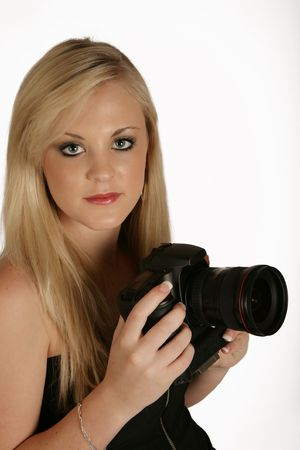 A woman holding a digital camera in her hands photo