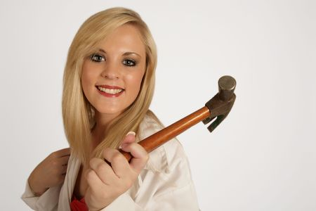 A woman holding a hammer in her hand