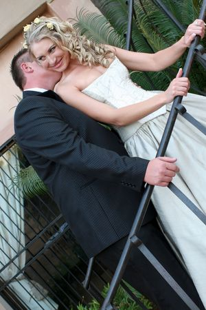 Young bride on her wedding day with her husband photo