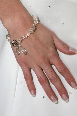 A bride wearing a beaded bracelet