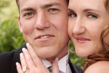 A portrait of a bride and groom standing close Stock Photo - 2750476