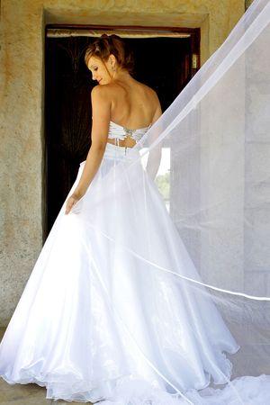 Bride standing in her wedding dress