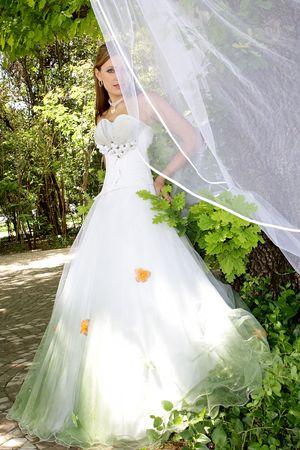Bride standing outside in her wedding dress