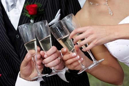 People drinking champagne with wedding couple Stock Photo