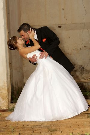 A groom holding his bride close Stock Photo