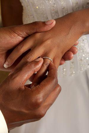 Groom putting on wedding ring Stock Photo