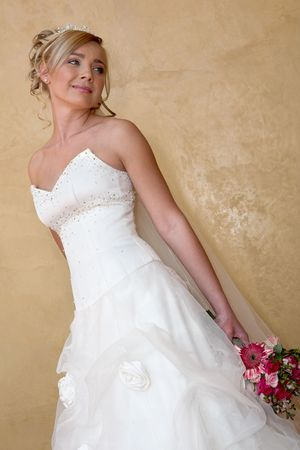 A bride standing againts a wall