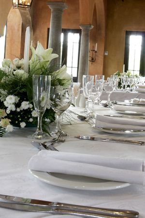 A table decorated and set for a wedding reception
