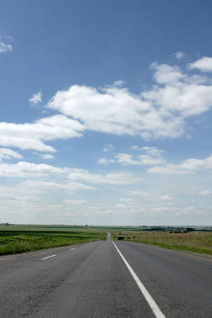 coutryside: A road in the coutryside with a blue sky