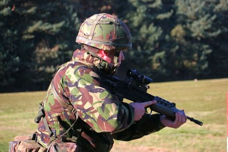 Marine firing an SA80 photo