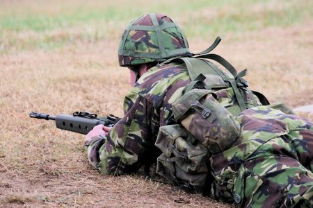 fatigues: Soldier resting