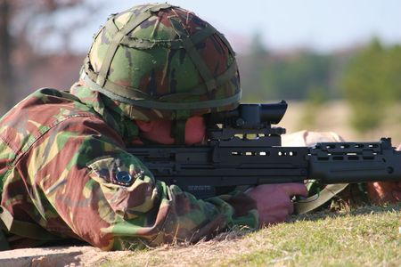 soldier firing close up photo
