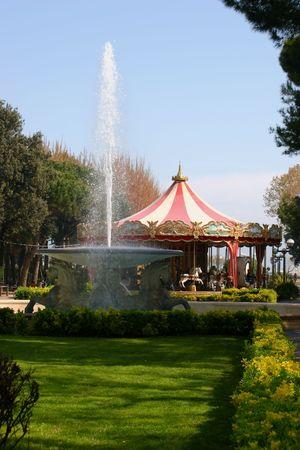 italian fountain: Carousel and fountain in an Italian park