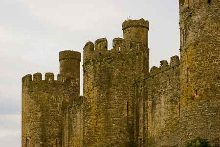 flagpoles: The walls of the ruined castle in Conwy. Wales