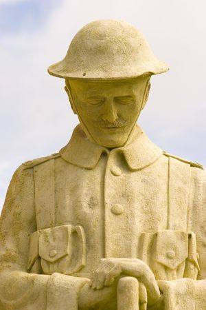head bowed: A statue of a soldier of the great war resting on his arms reversed with head bowed in rememberance
