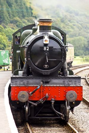arrives: A steam train arrives in the station on a preserved Victorian railway Stock Photo