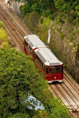 tramcar: The mountain tramway climbs uphill to the top of Victoria Peak in Hong Kong