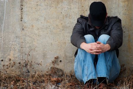 A homeless man sitting on ground folding his hands Stock Photo - 351940