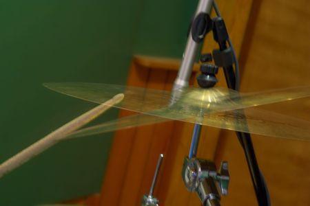 cymbal: A drummer hitting a cymbal Stock Photo