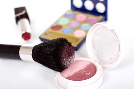 Cosmetic set: shadows, lipstick, blush Stock Photo