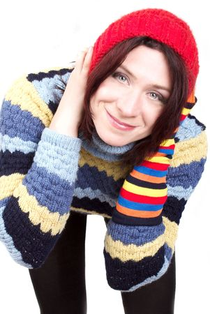 The attractive smiling woman in a red woolen cap photo