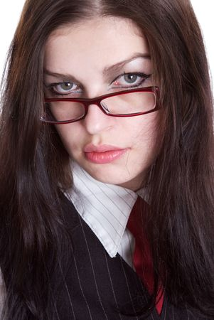 exacting: Portrait of the business woman in glasses. Studio shooting