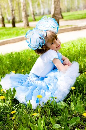 little girl playing on meadow Stock Photo - 7192421