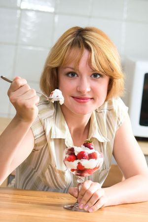 Nice girl eating strawberries and creams photo