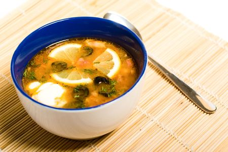 Russian and ukrainian cuisine - solyanka is a thick, spicy and sour soup photo