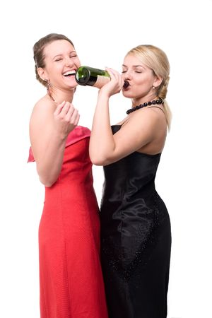 Two girls are drinking from a bottle of wine photo