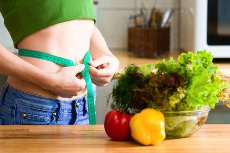 Measure tape around slim beautiful waist