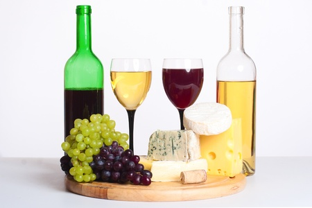two bottles of wine and lots of cheese and grapes Stock Photo - 8552583