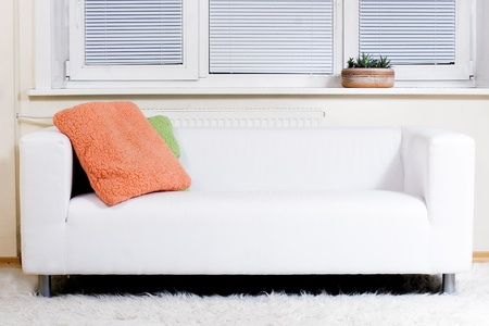 Modern white sofa and white carpet, front view photo