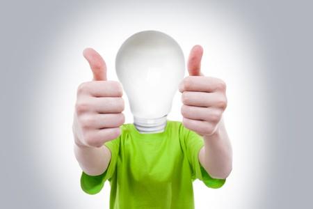 Big idea - boy with bulbhead Stock Photo - 15260988