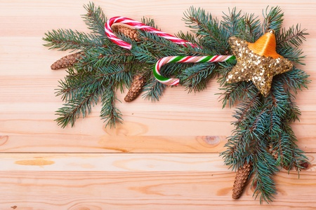 Branch of Christmas tree on wood  photo