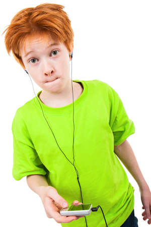 only boys: Redhead teen listens to music