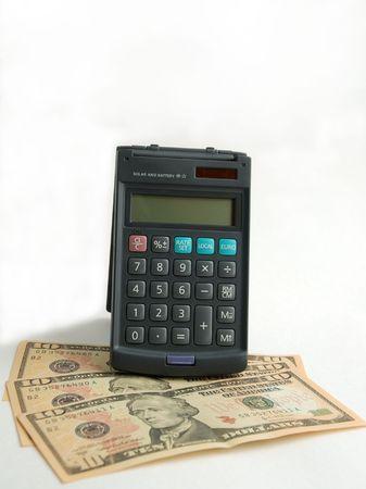 Money and calculator on white background photo