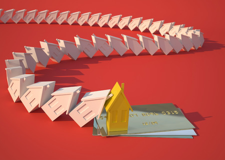 credit crisis: Real estate and gold credit card. Conceptual economic illustration about real estate, investments and finance crisis Stock Photo