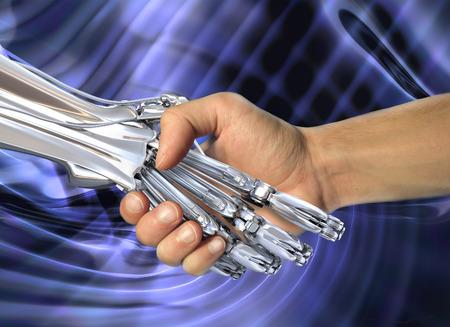 Robot y apretón de manos humano. Amistad entre la alta tecnología y las personas