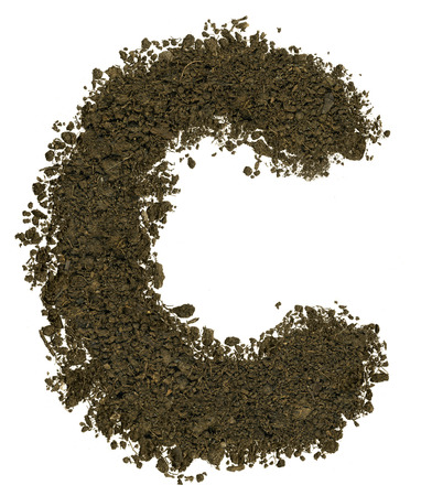 clod: Alphabet made of brown soil on white background. High sharp and detail. Letter C