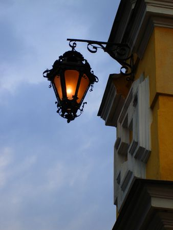 street lamp on a yellow wall in the evening Stock Photo - 606831