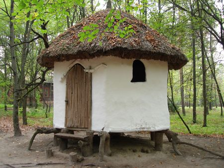 White small rural  log-house in a park Stock Photo - 606671