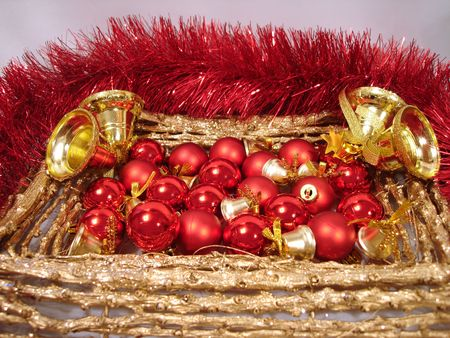 red Christmas balls and handbells on a golden frame with garland Stock Photo - 653723